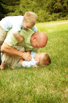 Dad roughhousing with boys