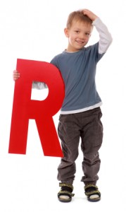 Confused Boy With Giant Letter R
