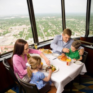 Family With Young Children Eating At Restaurant