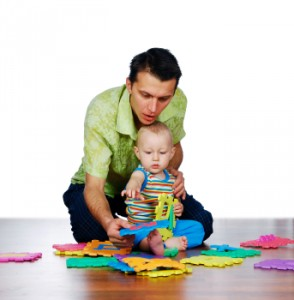 Young Boy Reaching For Toy