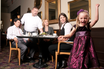 Young Girl Acting Up In Restaurant