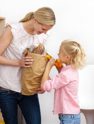 girl helping pack food