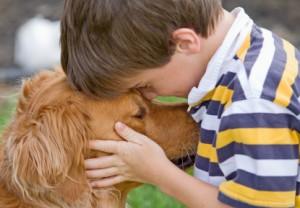 Young Boy Hugging Dog