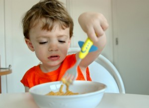 Young Boy Eating Noodles