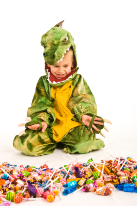 Boy in Costume Sorting Candy