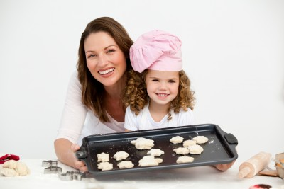 mom and child baking together