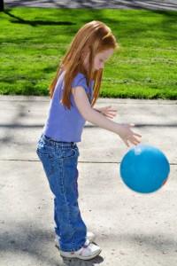 girl dribbling ball