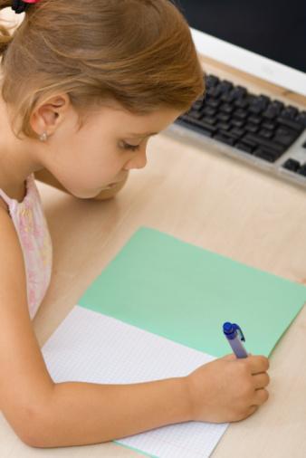 girl practicing writing