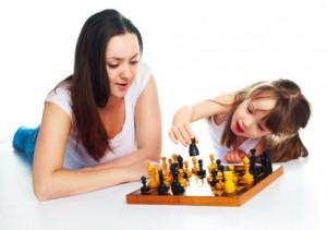girl and mom playing game on ground
