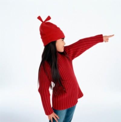 girl pointing left hand