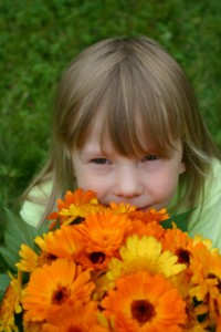 Girl smelling a flowers