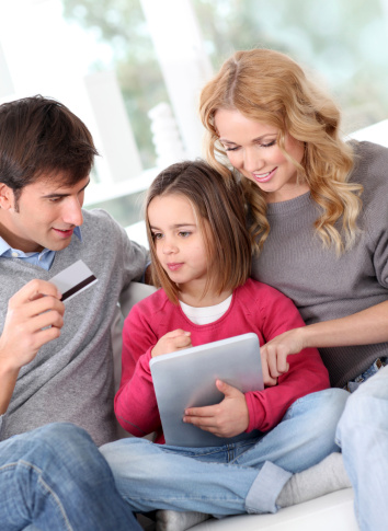 Parents with a child holding an iPad
