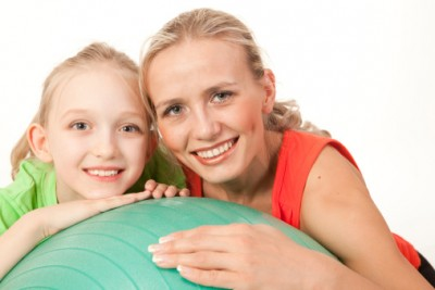 Mother and child with balance ball