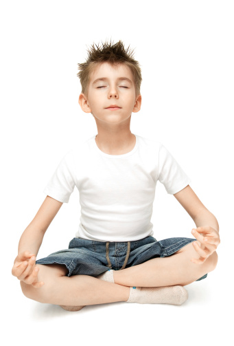 Little boy practicing a yoga position
