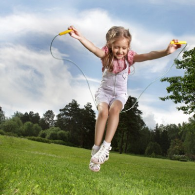 Little girl jumping a rope