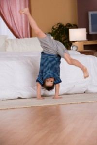 boy balancing on floor