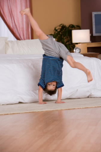 boy balancing on floor