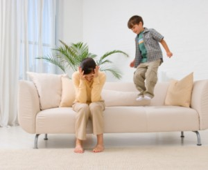 boy jumping on couch