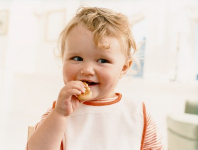 baby with finger food