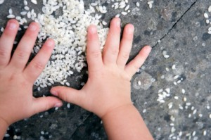 child playing with rice
