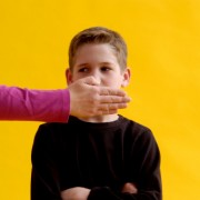 Child being told to be quiet