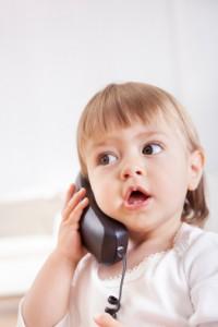 Baby speaking on phone