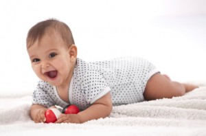 Laughing baby with ball