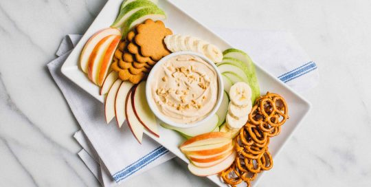 Peanut Butter Fruit Dip: Ready in minutes, this peanut butter yogurt dip pairs well with your favorite fruits, pretzels or cookies.