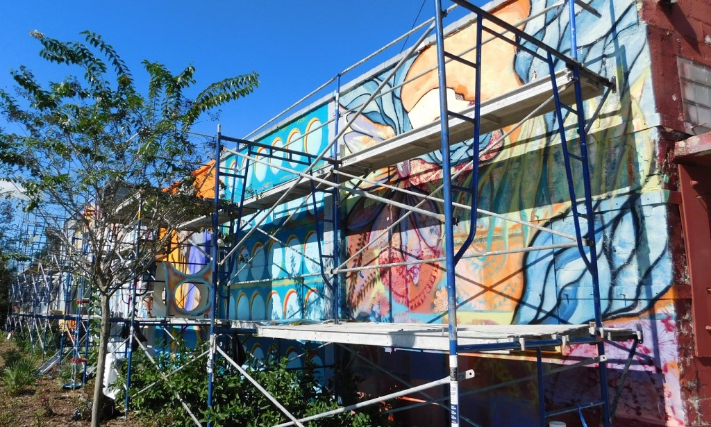 The mural project in progress on the former Discount Stereo Hi-Fi building on South Main Street.