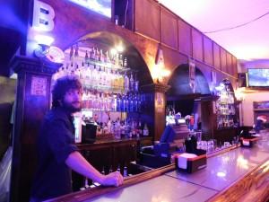 Josh Hubner behind the bar at The Bank.
