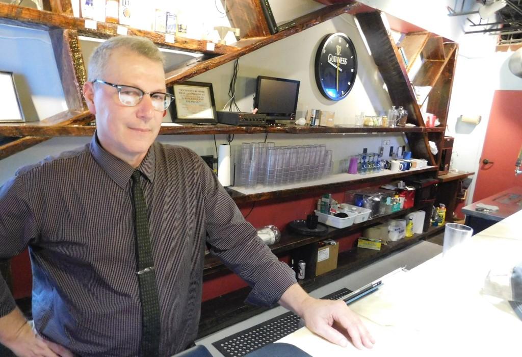 Owner Alan Bushnell behind the bar at the new Hardback Café.