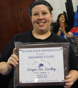 Chef Shanti Riesch and her second-place award for Emilianos Pork Chili Verde.