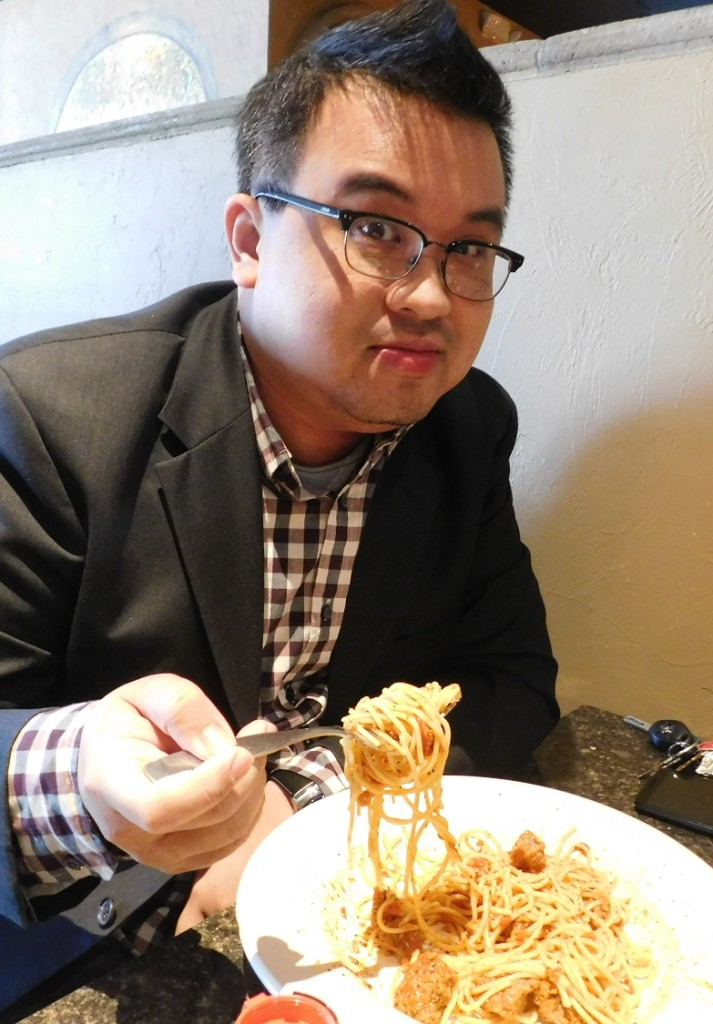 Ken Peng gets ready to chow down at Piesanos Stone Fired Pizza. Photo by Gainesville Downtown)