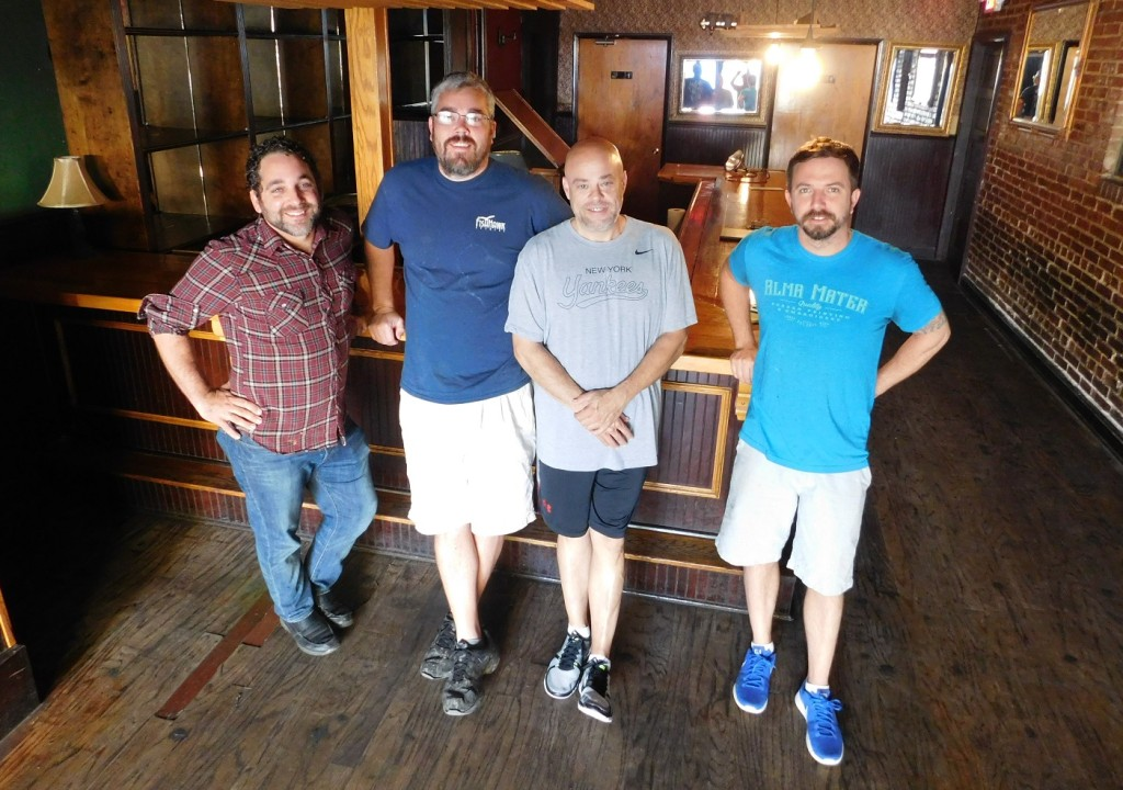 Dave Molyneaux, second from right, and his team at the Fish Hawk Tasting Room Photo by Gainesville Downtown)