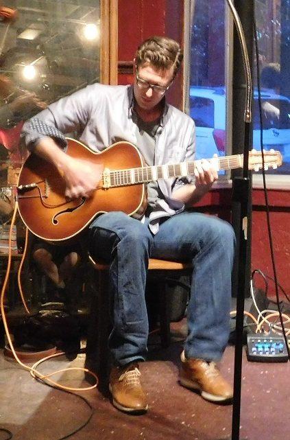Thompson Fletcher on rhythm guitar.