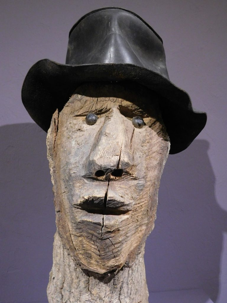 A woodcarving by Jesse Aaron that some say is a self-portrait. Photo by Gainesville Downtown)