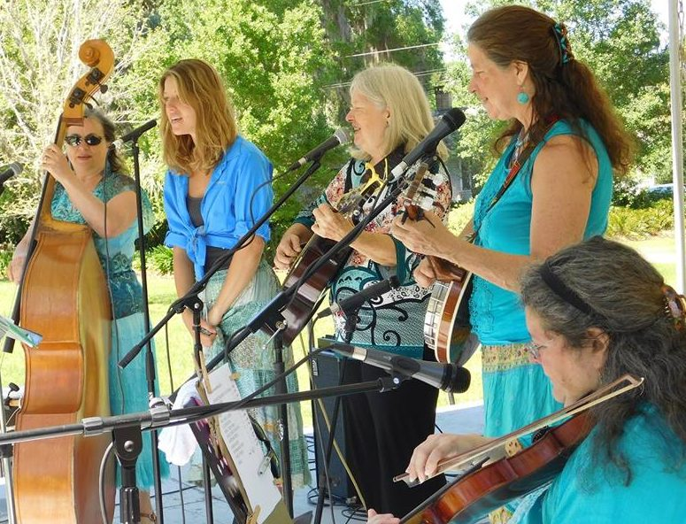 DeWitt, center, performs with her band Patchwork at the Santa Fe Springs Arts Festival. Photo by Gainesville Downtown)