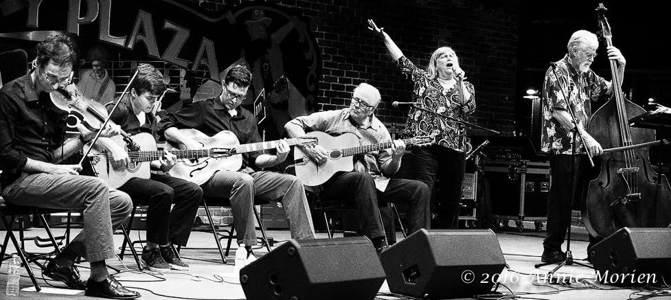 Hot Club de Ville performs Friday night at Bo Diddley Plaza. The group includes, from left, Jacon Lawson, Erik Abernathy, Thompson Fletcher, Marty Liquori, Patti Markoch and Dave Forbes
