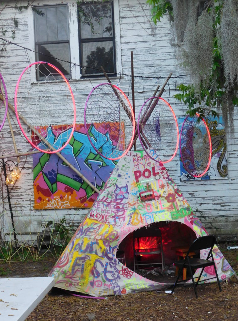 A teepee serves as a fireplace in the colorful courtyard behind the Jam.