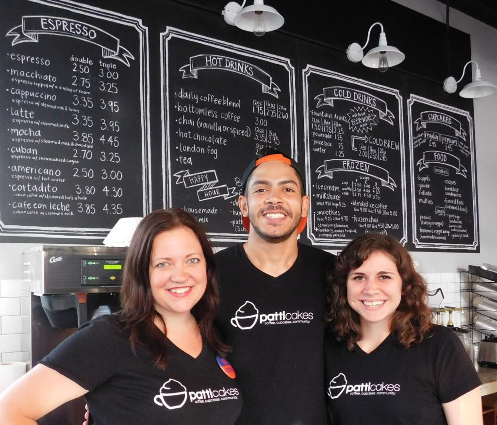 Erin Leigh Patterson, left, with Patticakes employees Josue Benitez and Catherine Caple. Photo by Gainesville Downtown)