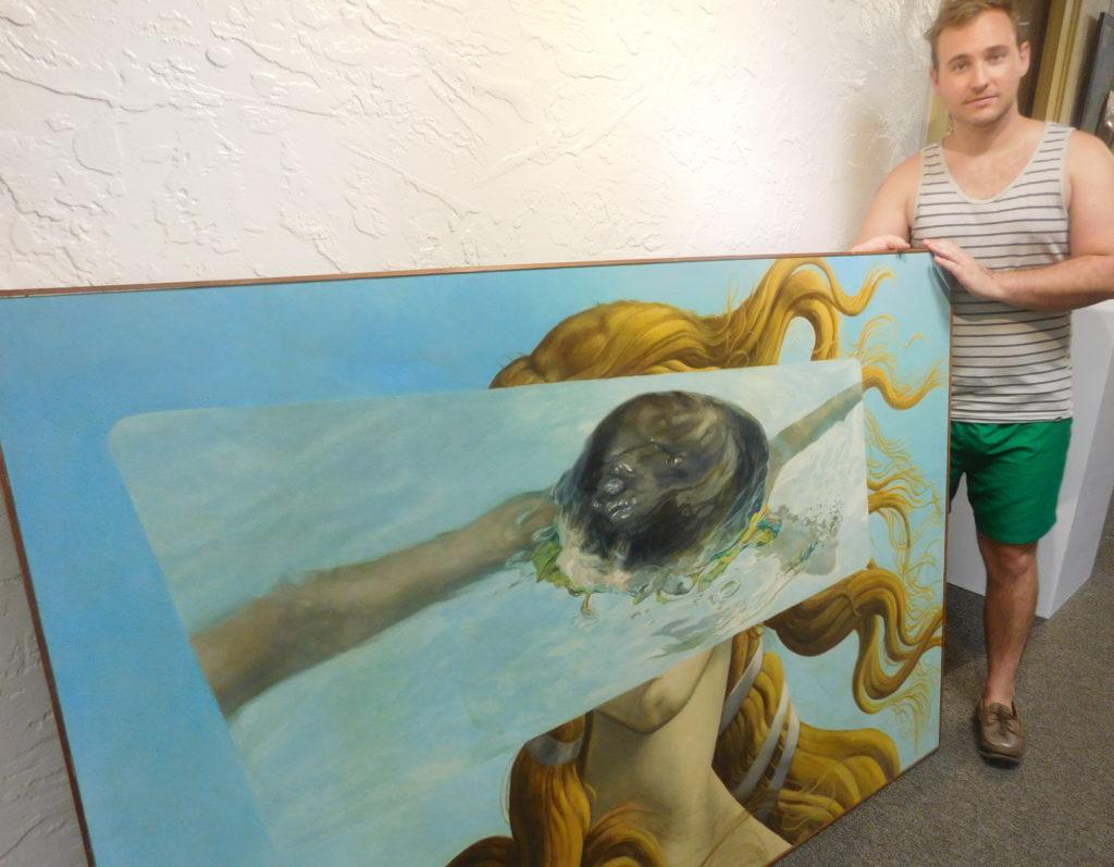 "Adam Germann prepares to install John Wards painting ""Venus."""