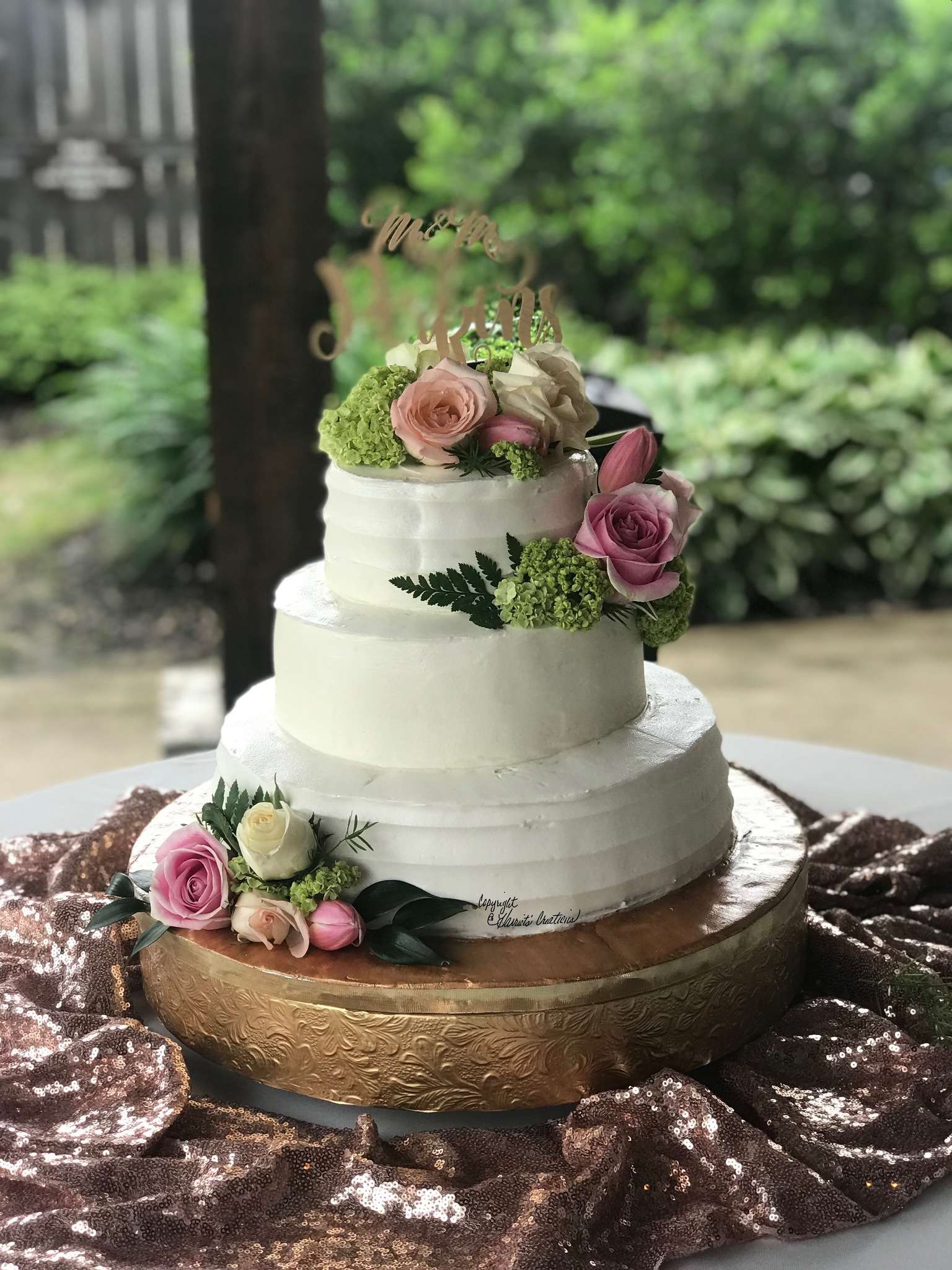 combed wedding cake with flowers