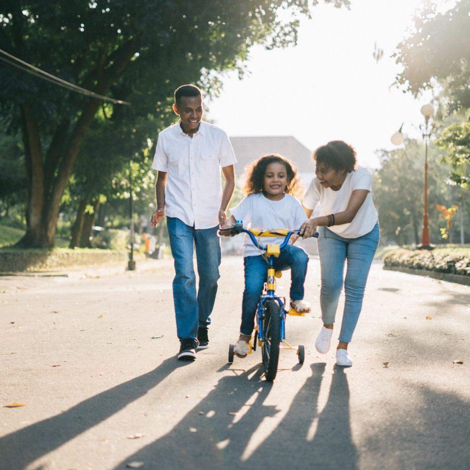 Family Teaching girl to ride Bike - Advanced Family Mediation in Austin Mediators and Arbitrators of America