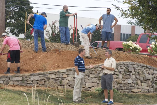 Students finishing up wall.  Kevin Parris & Bob  Polomsky just standing around.