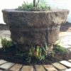 Earthform urn with a craborchard stone block surround.