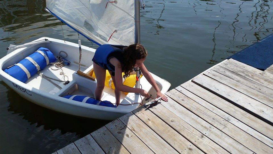 student docking sailboat