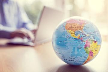 globe and laptop