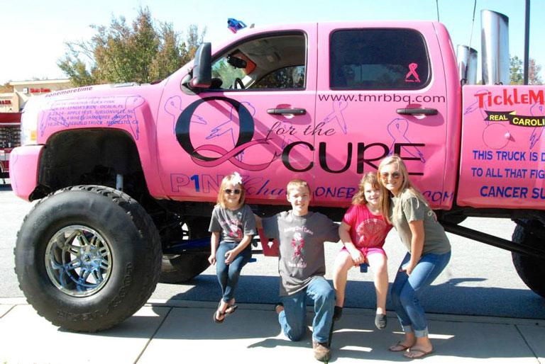 children posing with truck