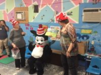 """ELC of North Florida volunteers Sally Leitzman and Sara Pines read with special guest """"The Cat in the Hat"""" to children at The Children's Academy of Interlachen."""