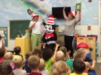 """ELC volunteers Cathy Voss, Teresa Widman and special guest """"The Cat in the Hat"""" enjoy story time at KidsFirst Learning Center in Middleburg."""